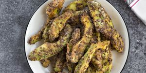 Prepared avocado fries with salsa and garlic dip