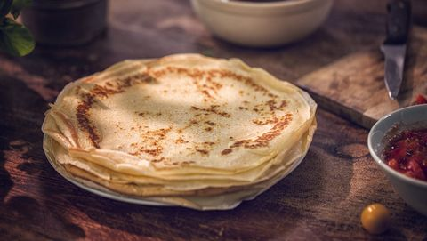 Preparing Baked Crepes Pancakes with Ham and Tomatoes