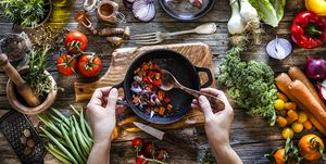 Cooking topics: preparing tomato sauce on rustic kitchen table