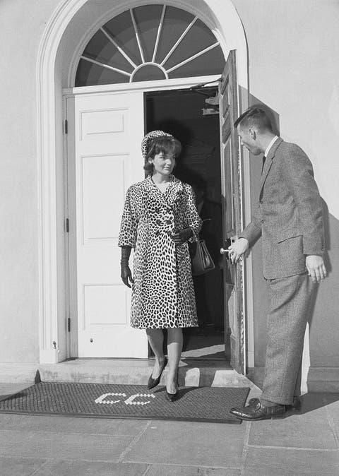 man holding door for mrs jacqueline kennedy