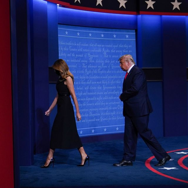 melania trump and donald trump exiting the stage separately