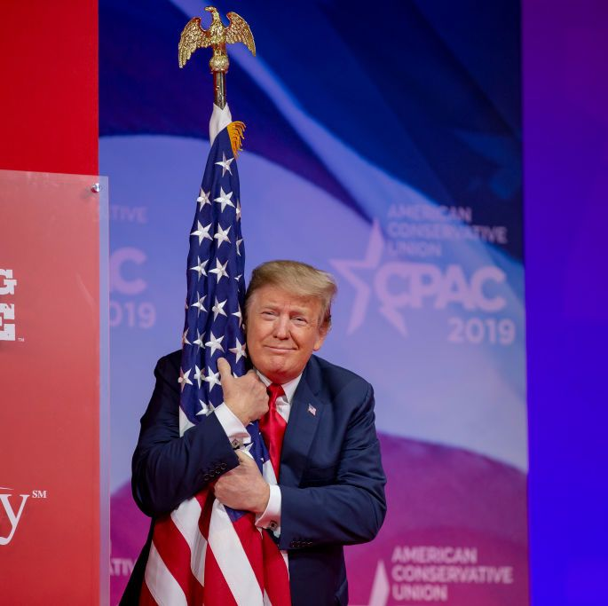 The president hugged an American flag after taking the stage at CPAC.
