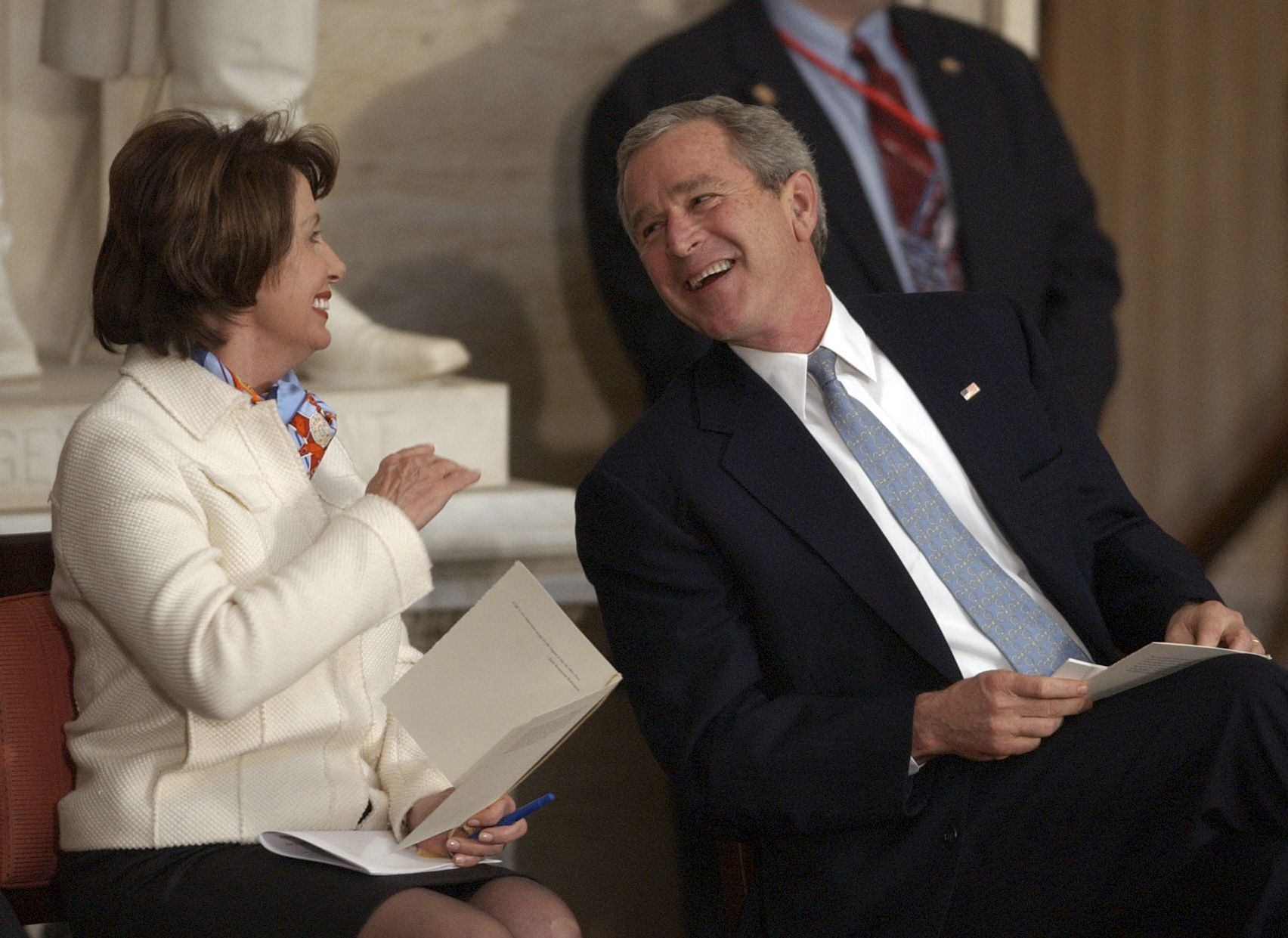 George W. Bush and Pelosi share a laugh while attending the Congressional Gold Medal ceremony.