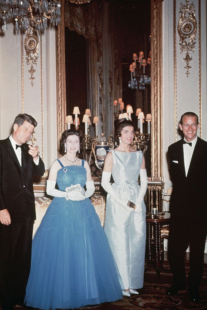 American royalty met actual royalty when President John F. Kennedy and Jackie Kennedy visited Buckingham Palace for the first time. The Queen wore a blue ballgown by Norman Hartnell with white gloves for the occasion.