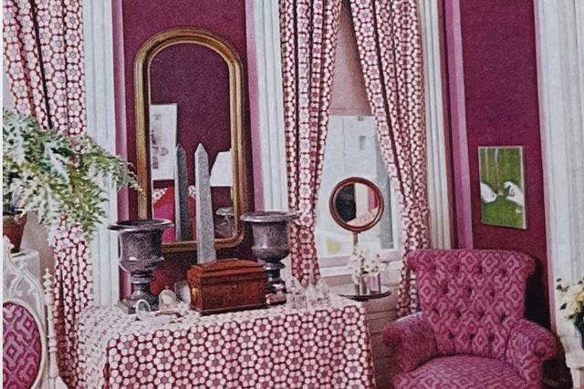 pink room with mirror