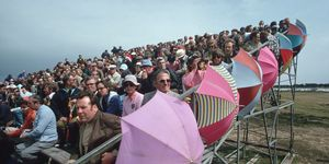 Spectators With Umbrellas in the Grandstands