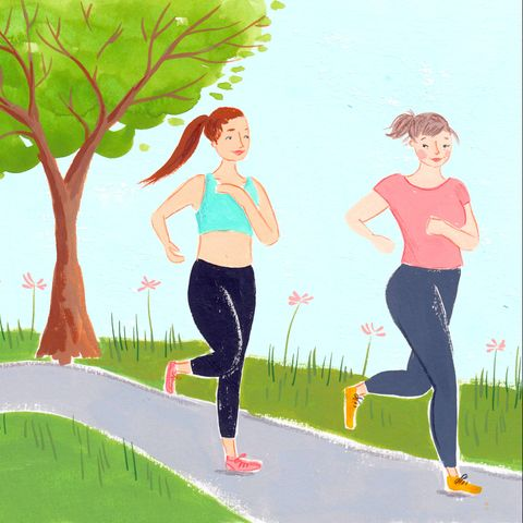 wo women running along a path, wearing sportswear, with a tree in the background