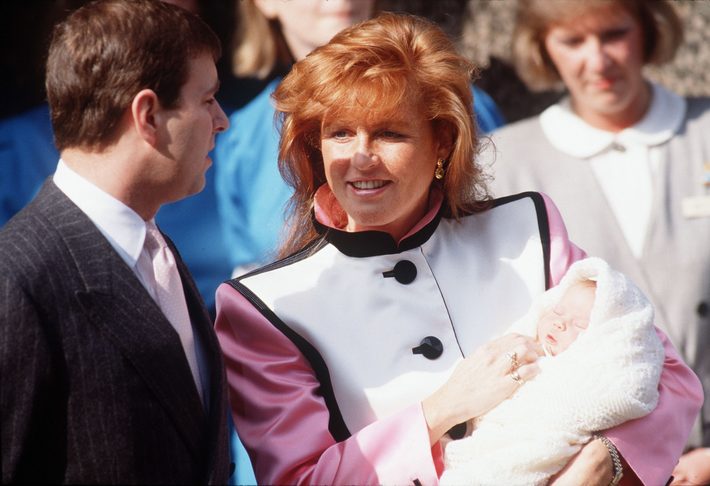 Prince Andrew with Sarah, Duchess Of York, leaving the Portland Hospital with their daughter, Princess Eugenie in March of 1990.