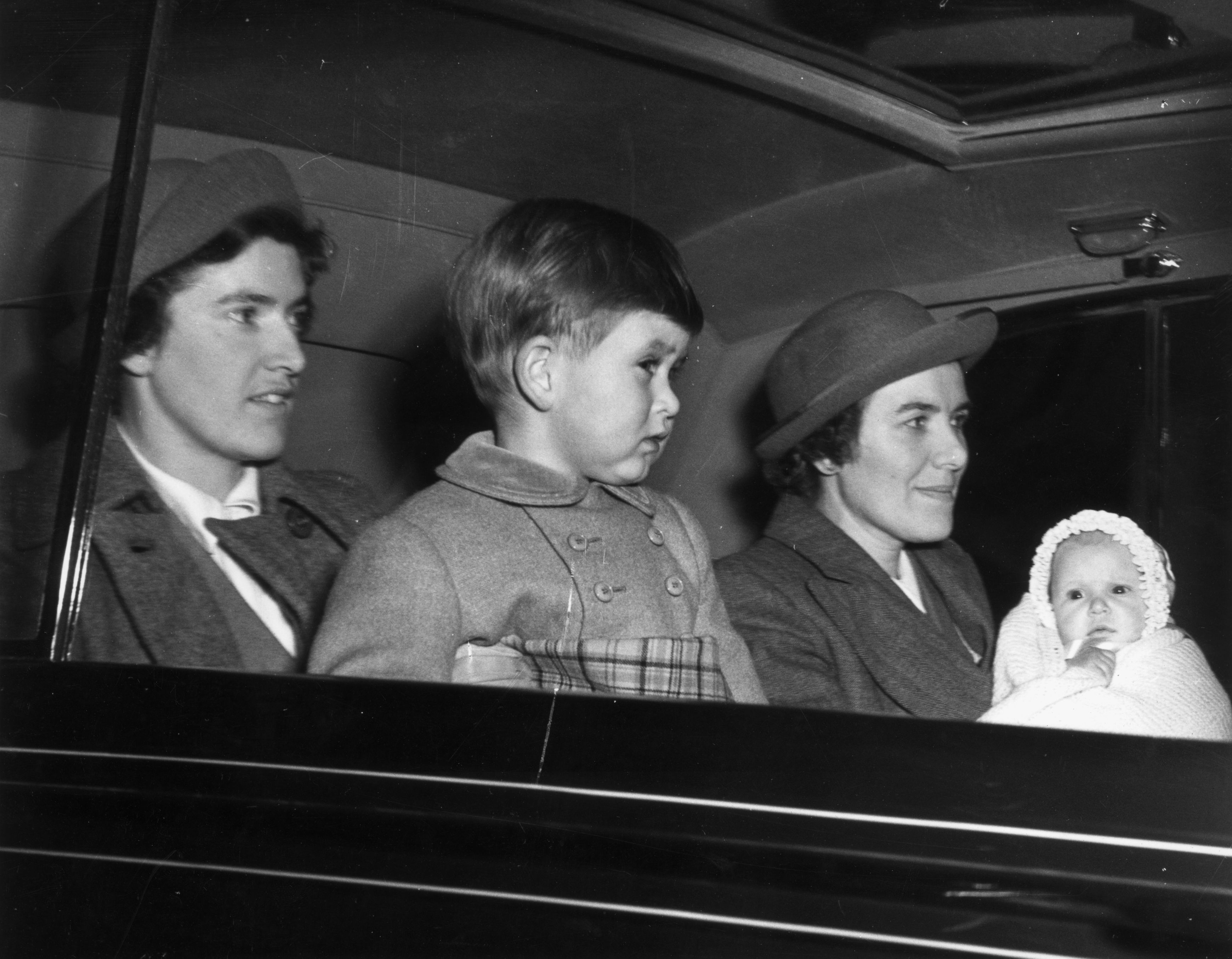 Prince Charles and Princess Anne in the company of their nurses in 1950. They are on their way to Sandringham to spend Christmas with their grandparents, King George VI and Queen Elizabeth.