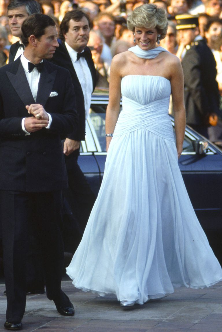 Diana wore this memorable number to a gala during the Cannes Film Festival. The pale blue flowing chiffon dress was designed by Catherine Walker, one of Diana's favorite designers.