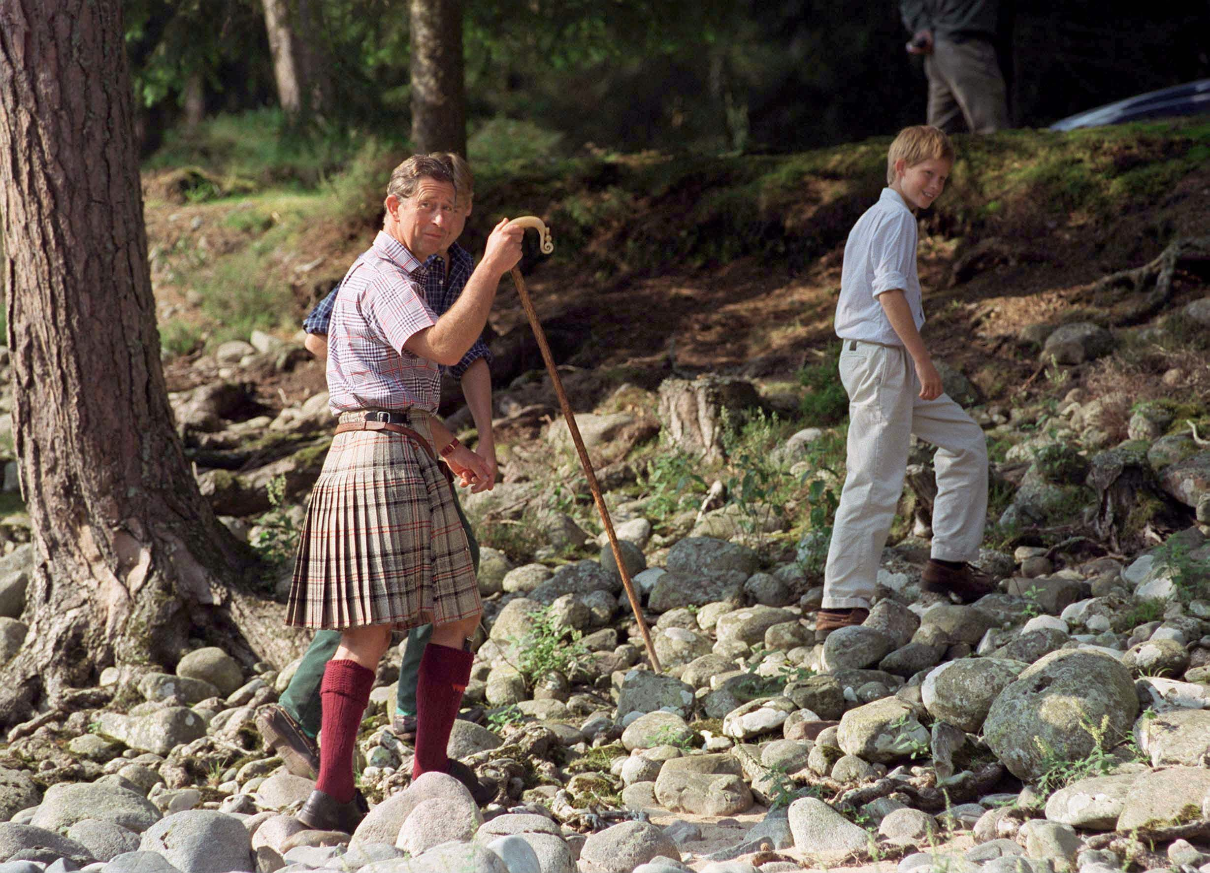Charles, Harry, and William on the Balmoral Castle Estate in 1997.