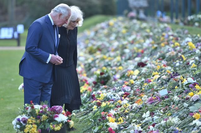 the prince of wales and the duchess of cornwall view tributes left by members of the public following the death of the duke of edinburgh