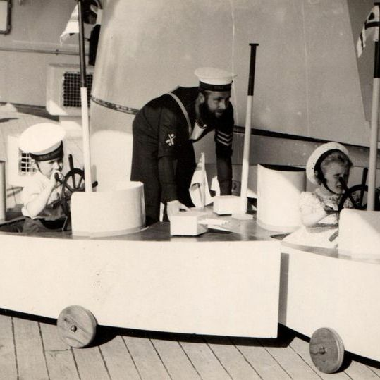 A young Prince Charles and Princess Anne play on the Royal Yacht Britannia.