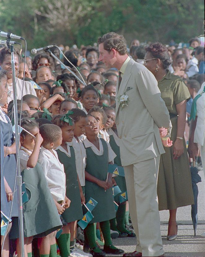 Prince Charles Speaks with children in St. Lucia in 1989.