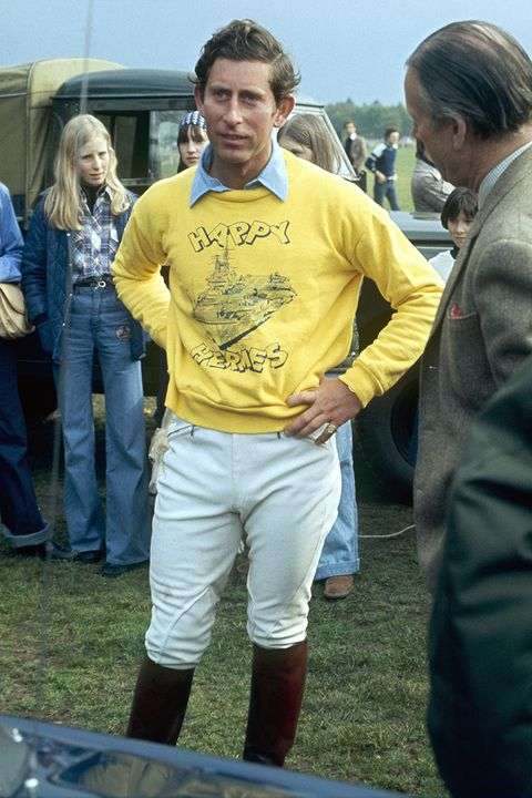 a young prince charles wearing  a yellow hermes sweater and jodhpurs and knee high boots