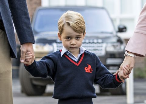 topshot   britains prince george c accompanied by britains prince william l, duke of cambridge arrives for his first day of school at thomass school where he is met by helen haslem r head of the lower school in southwest london on september 7, 2017 photo by richard pohle  pool  afp photo by richard pohlepoolafp via getty images