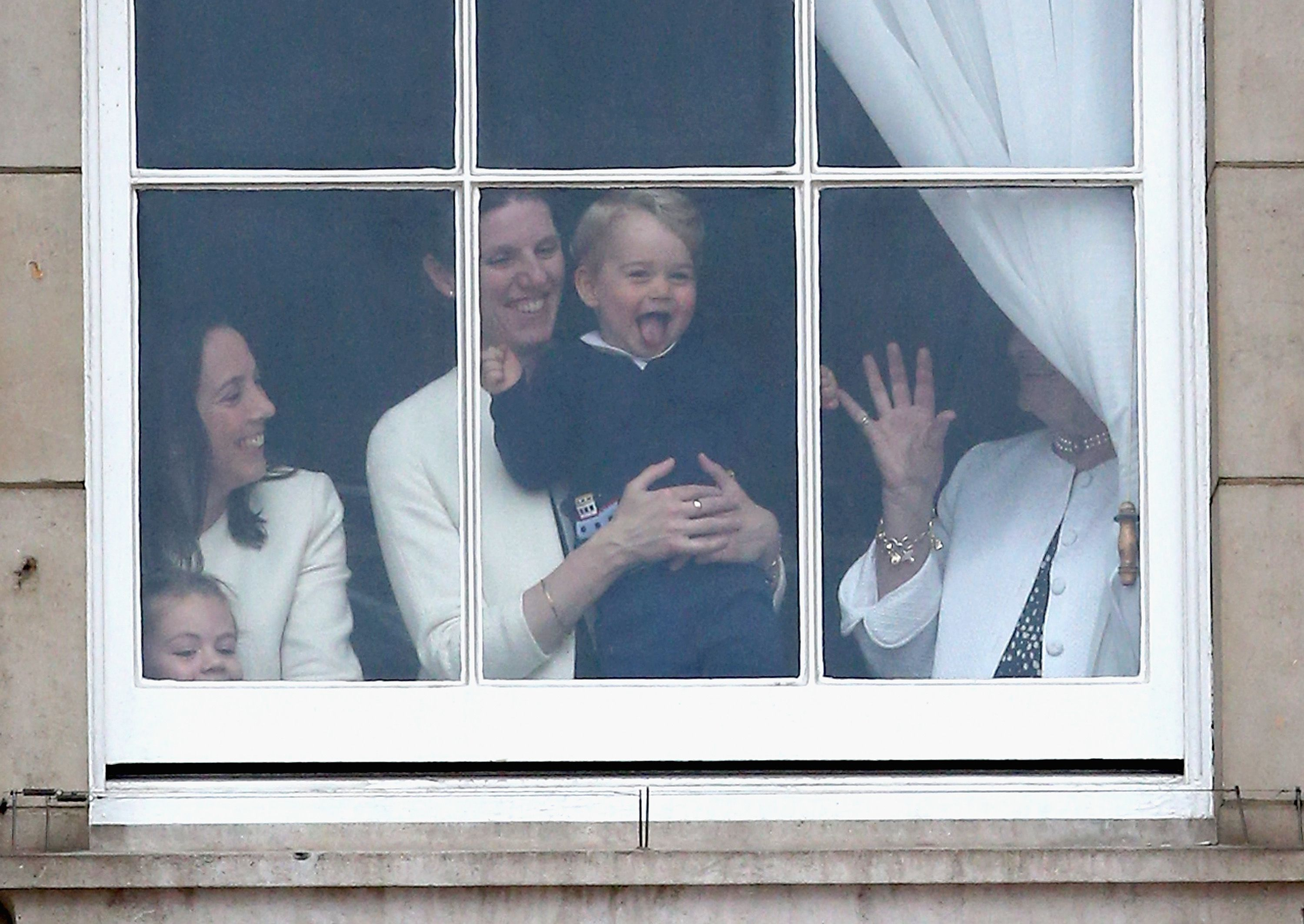 Prince George and Nanny Maria are spotted through a window the 2015 Trooping the Colour parade.