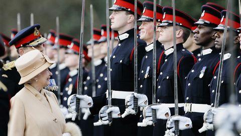 Uniform, Hat, Parade, Headgear, Collar, Costume accessory, Cap, Soldier, Military organization, Military,