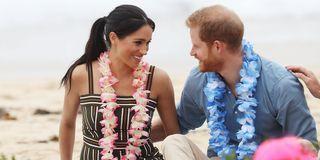41d1ac96b Meghan Markle Wears Sundress with Thigh-High Split on Fraser Island for Prince  Harry PDA