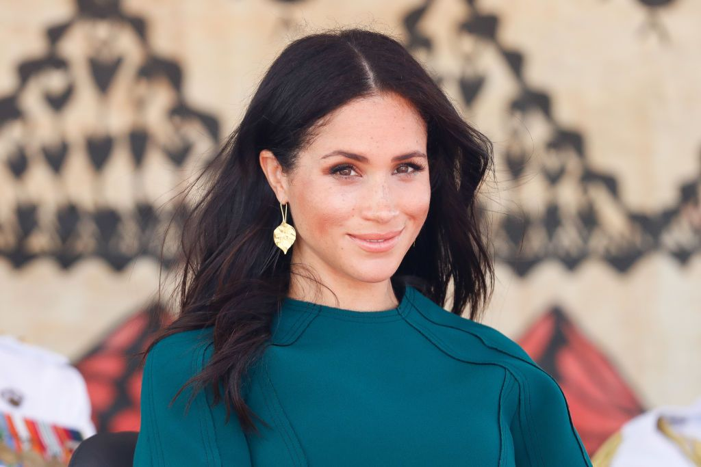 The Duchess of Sussex looks thrilled on set shooting her capsule collection