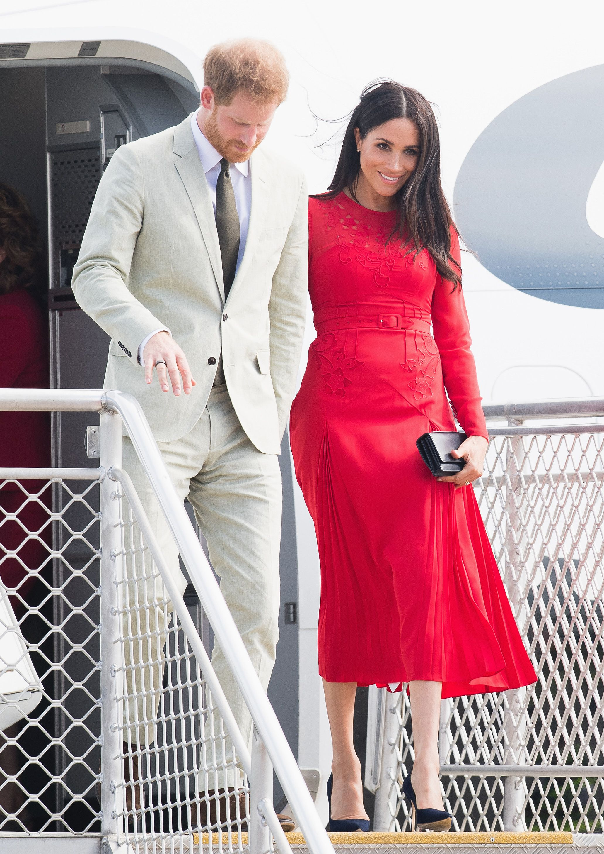 76640f3d7ce9 Meghan Markle Wears Red Self-Portrait Dress for Her and Prince Harry's  Tonga Arrival During Royal Tour