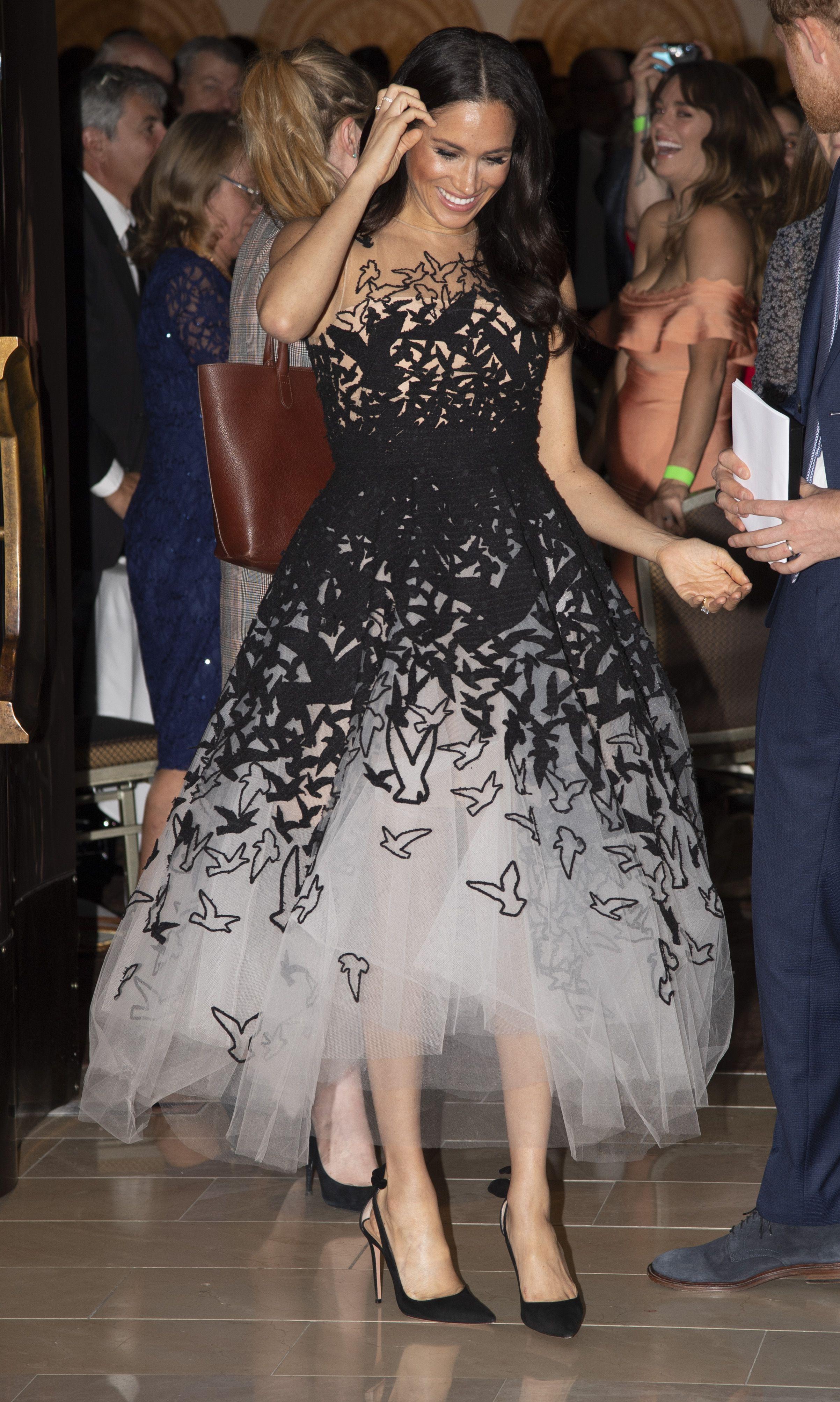 e872630d4687 Meghan Markle Steps Out in Sydney Wearing a Graphic Oscar de La Renta Gown