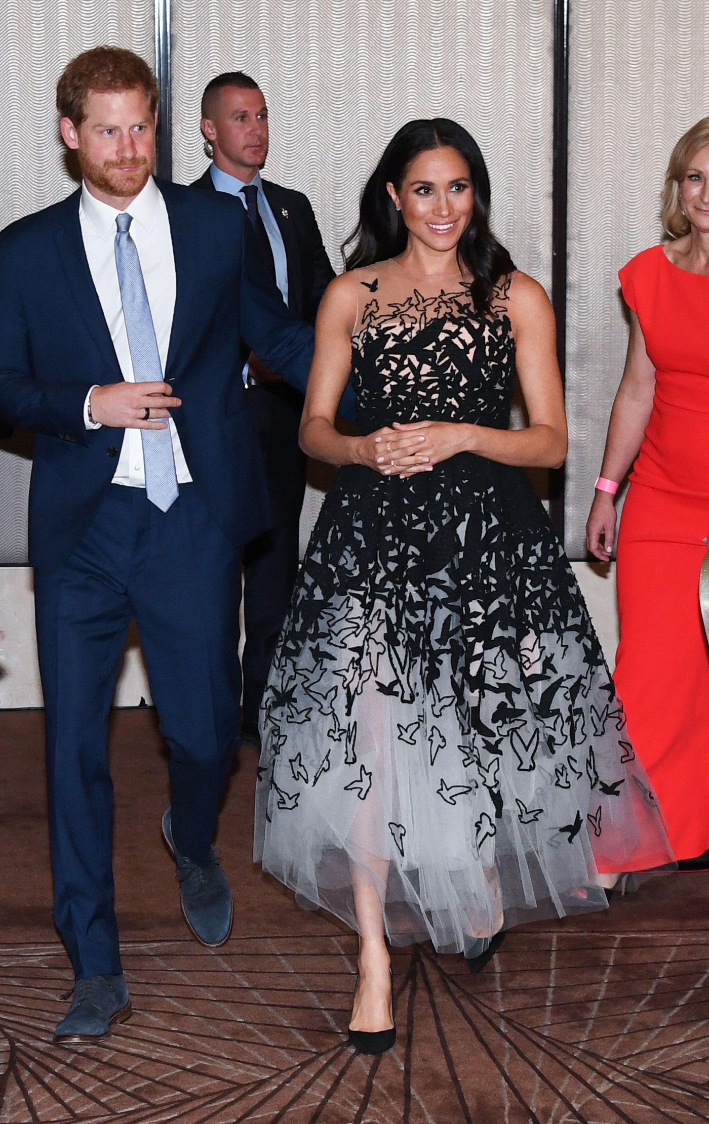 Back in Sydney after a whirlwind day in Tonga, Harry and Meghan changed into formal attire for an elegant evening at the Australian Geographic Society Awards. The Duchess wore a black and white gown by Oscar de la Renta for the night.