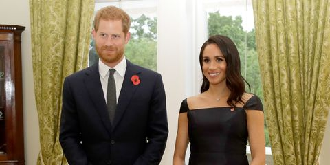e5a6c091c7 Meghan Markle Wore a Black Dress to Her and Prince Harry's Secret ...
