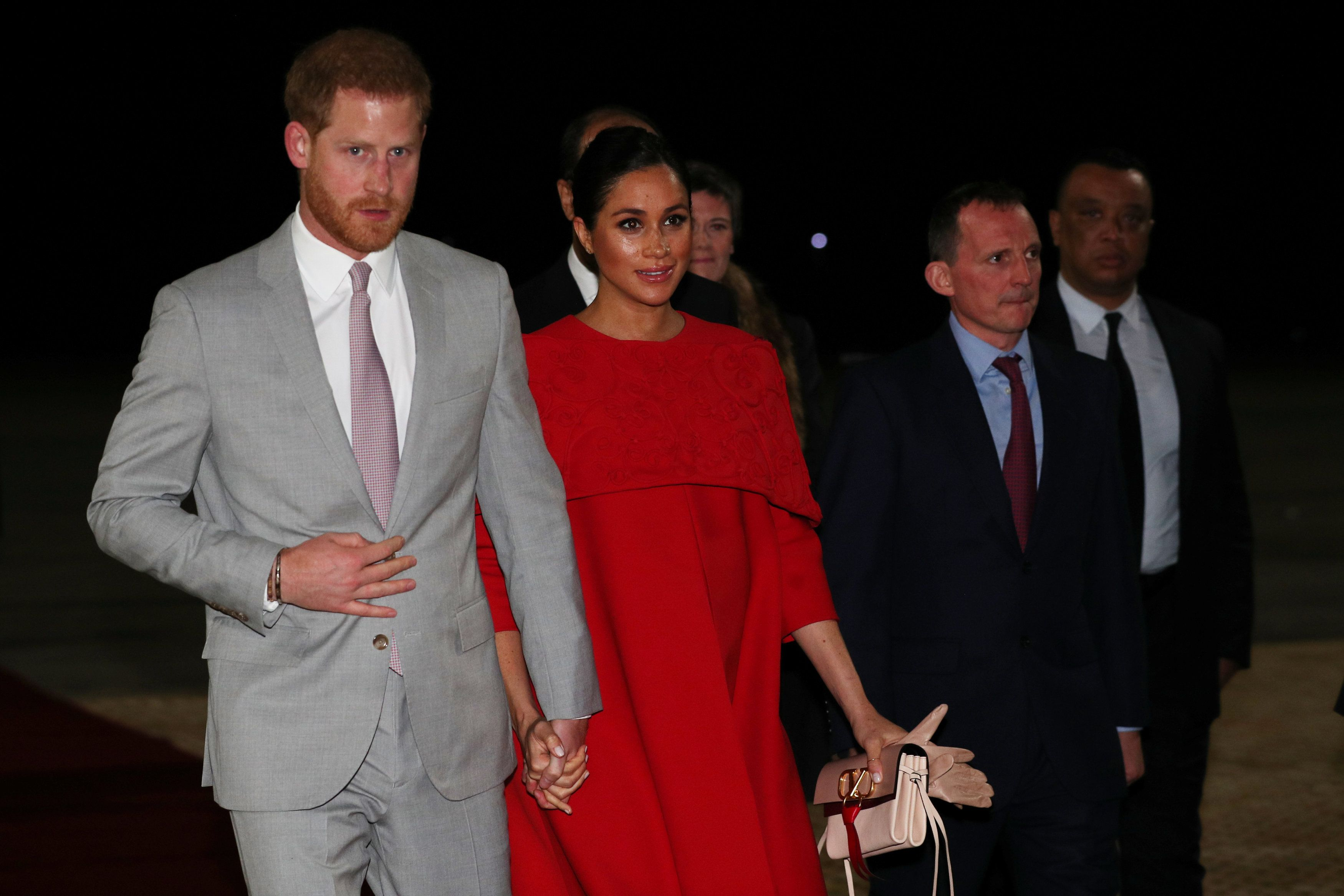 Meghan Markle Just Arrived in Morocco Wearing a Striking Red Valentino Cape Dress