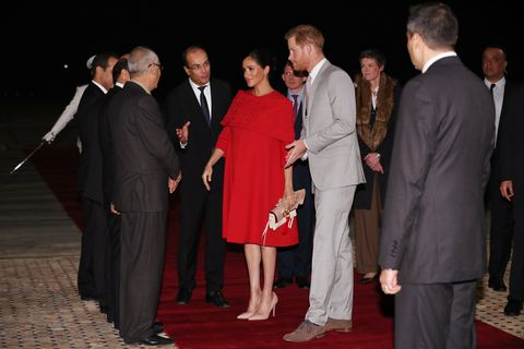 3f218a2607f Meghan Markle Just Wore a Red Valentino Cape Dress For Her First Day ...