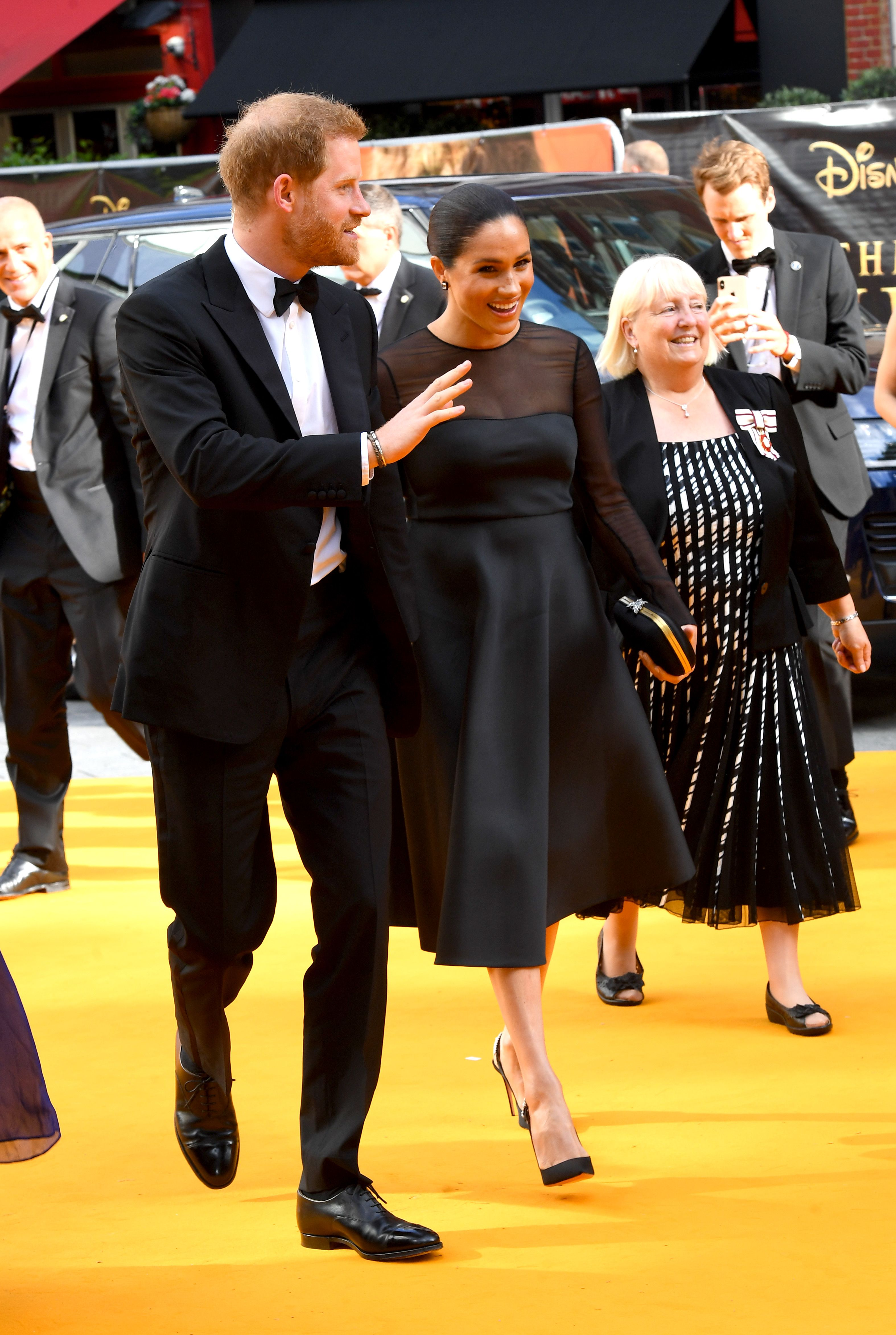 Meghan Markle and Prince Harry Matched in Chic Black Ensembles at the Lion King Premiere