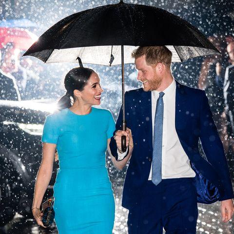 prince harry and meghan markle love their raining umbrella photo prince harry and meghan markle love