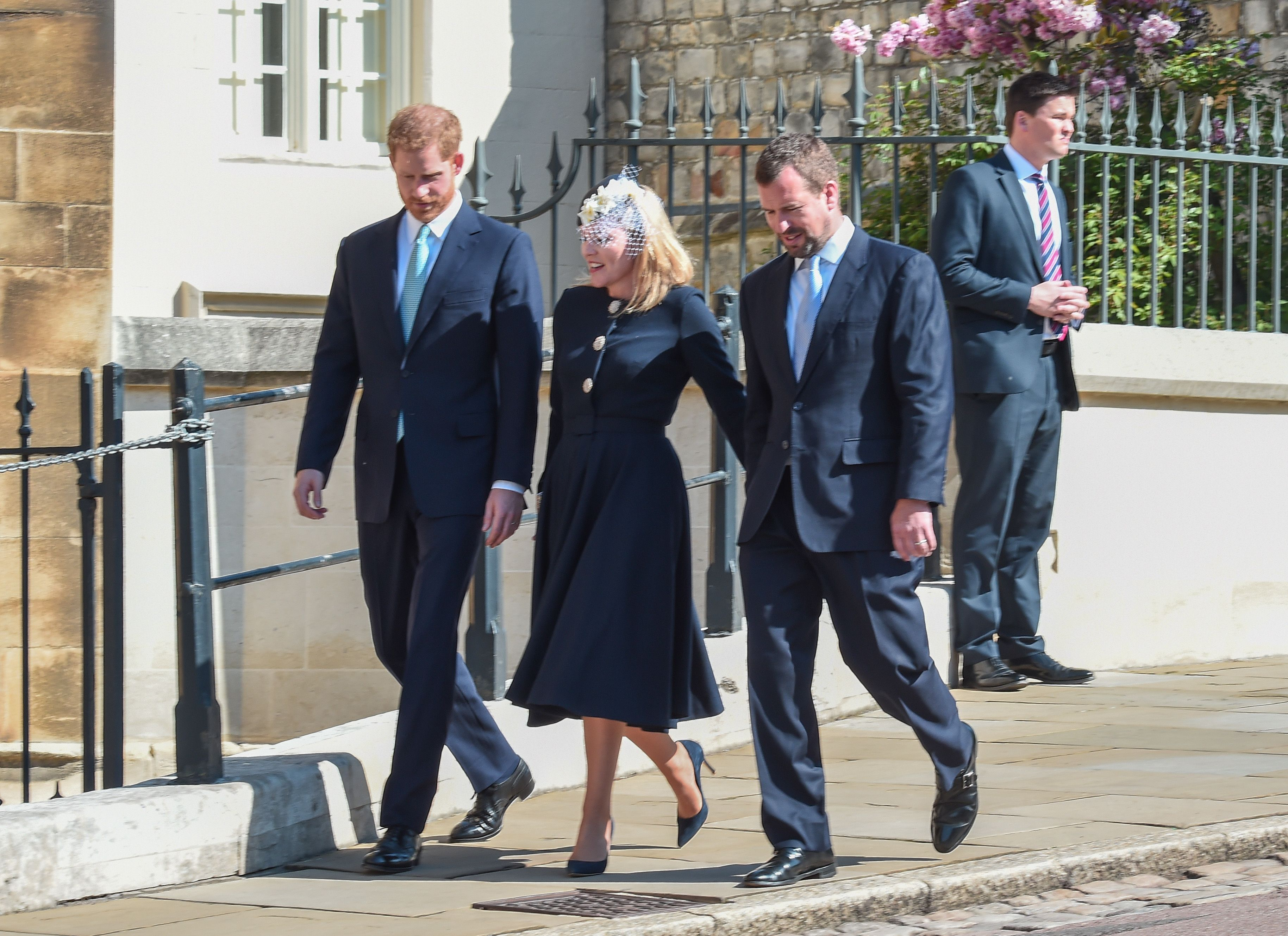 Prince Harry arriving at St. George's Chapel alongside his cousin Peter Phillips and his wife Autumn.