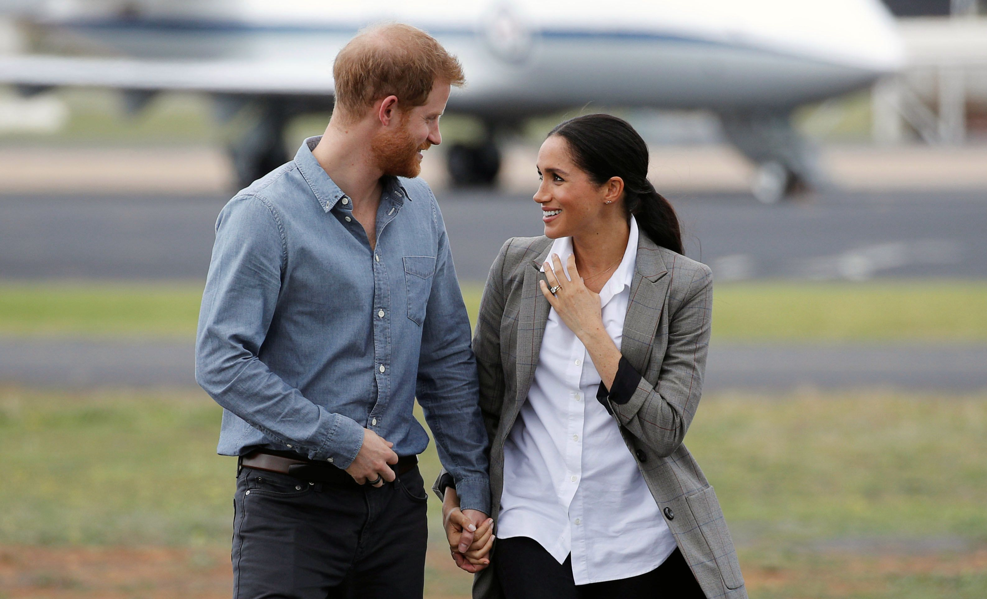 "Prince Harry and Meghan Markle Are Apparently ""Besotted"" With Each Other Amid Their Royal Exit"
