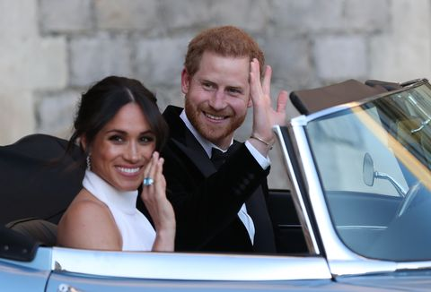 Meghan Markle and Prince Harry in a Jaguar