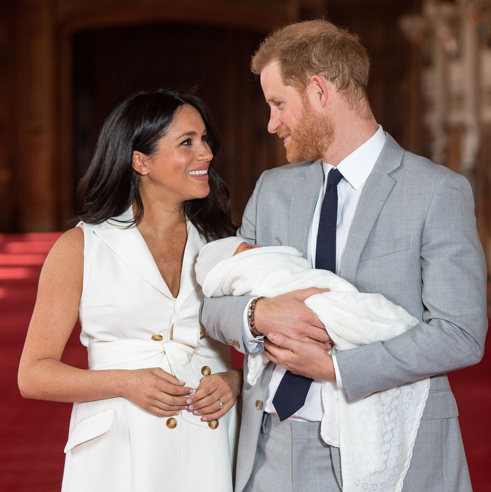 The sweet message Prince Harry whispered to Meghan before their photocall with Archie
