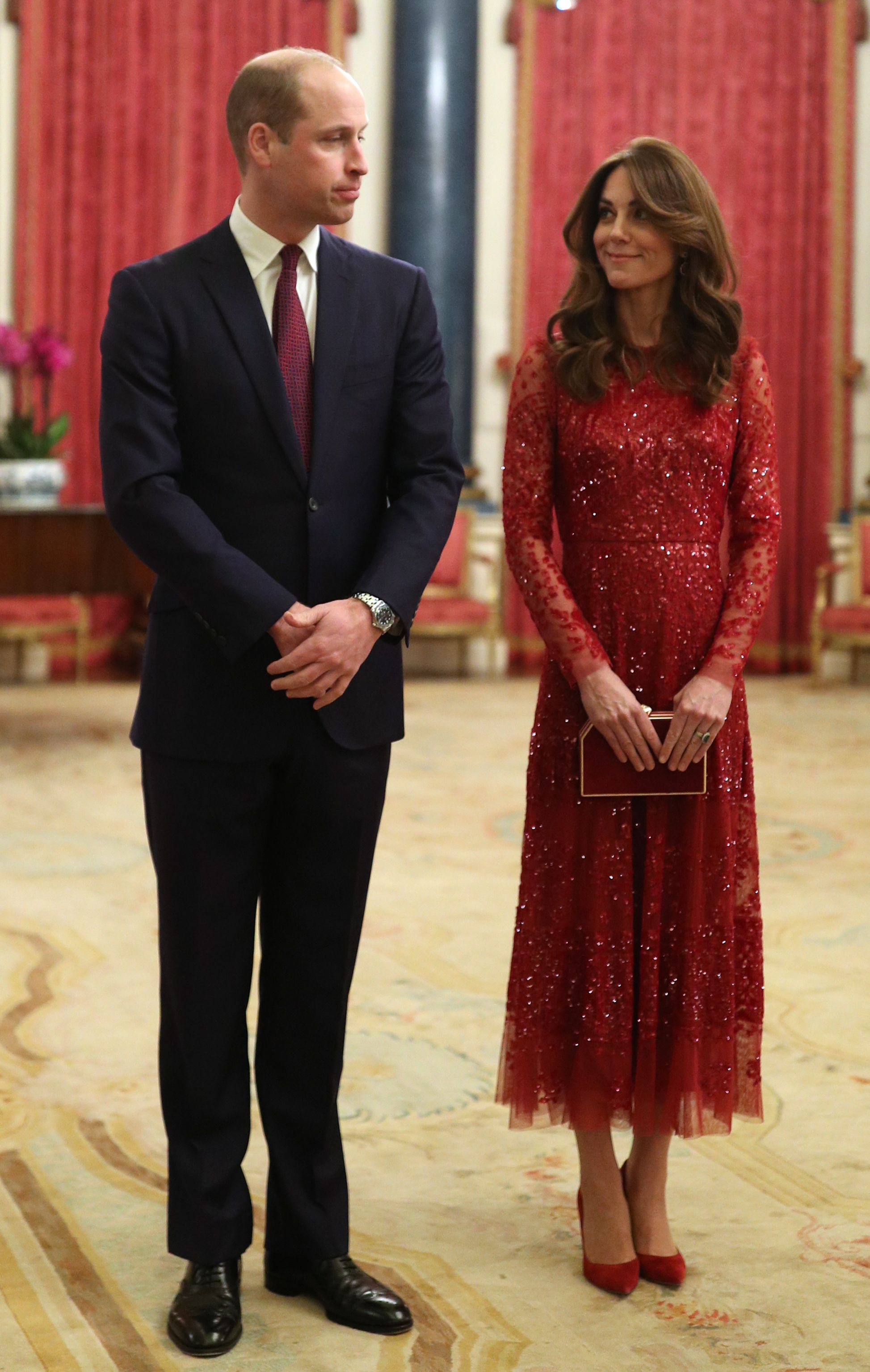 See Kate Middleton Pop Out in Red At Prince William's First Solo Buckingham Palace Reception