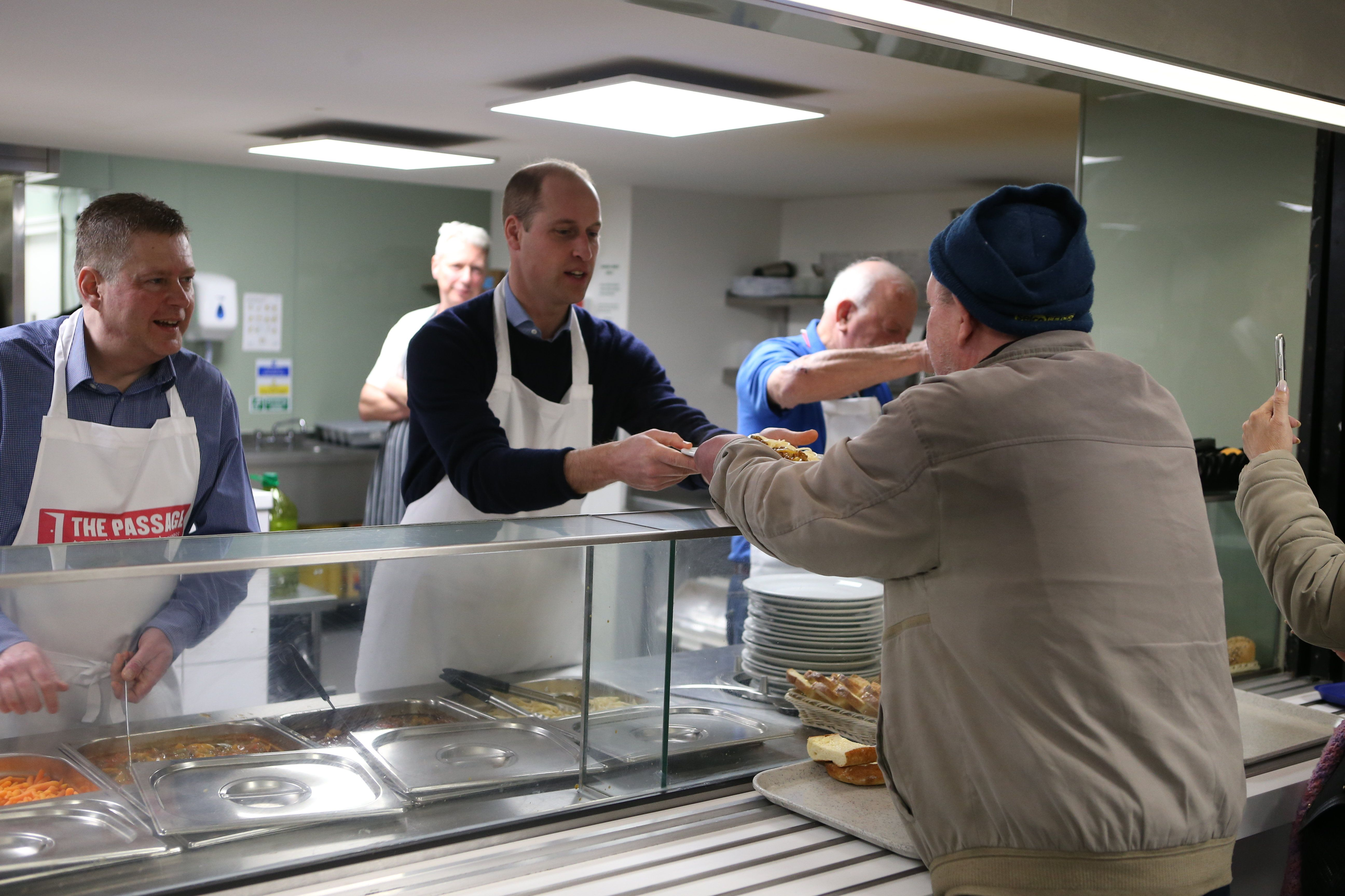 Prince William serves food at The Passage Charity.