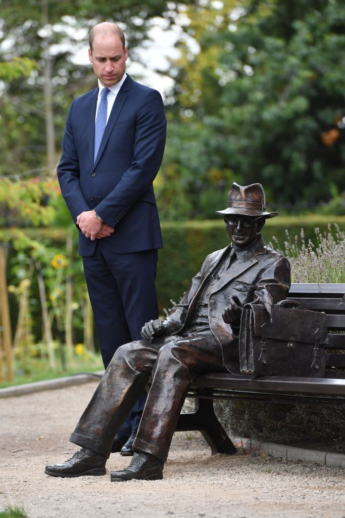 Prince William standing next to the newly unveiled statue.