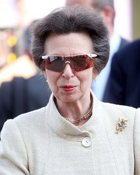 princess anne wears speeddealer sunglasses with an ivory coat and brooch for a public appearance