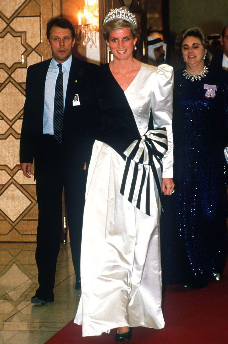 In true 1980s fashion, Princess Diana wore a black and white evening gown with a giant bow in the front to a royal wedding in Saudi Arabia. The royal also wore the ultimate piece of jewelry: a stunning tiara.