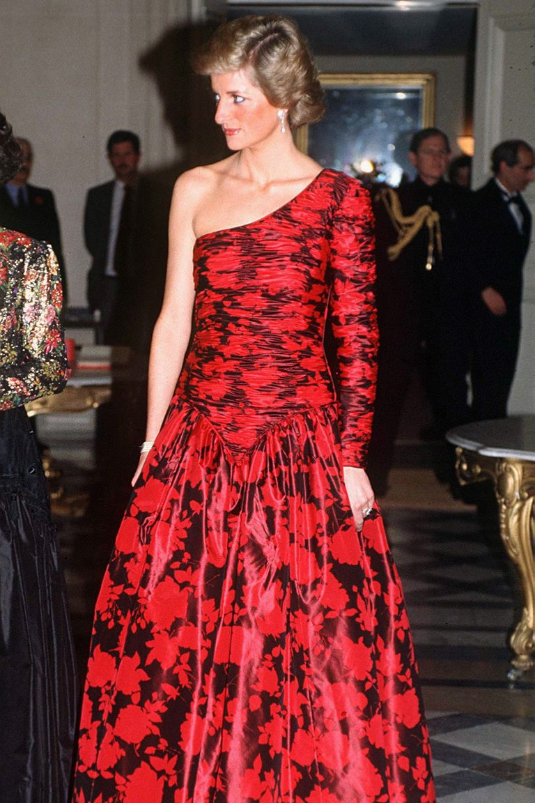 Diana wore a dress that was quite striking for the era: a red and black patterned one shoulder dress. The Princess wore the Catherine Walker evening gown to a dinner hosted by the British Ambassador while in Paris.