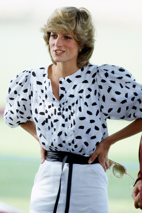 princess diana watching a polo match in cirencester wearing a black and white printed outfit with sunglasses in her hand