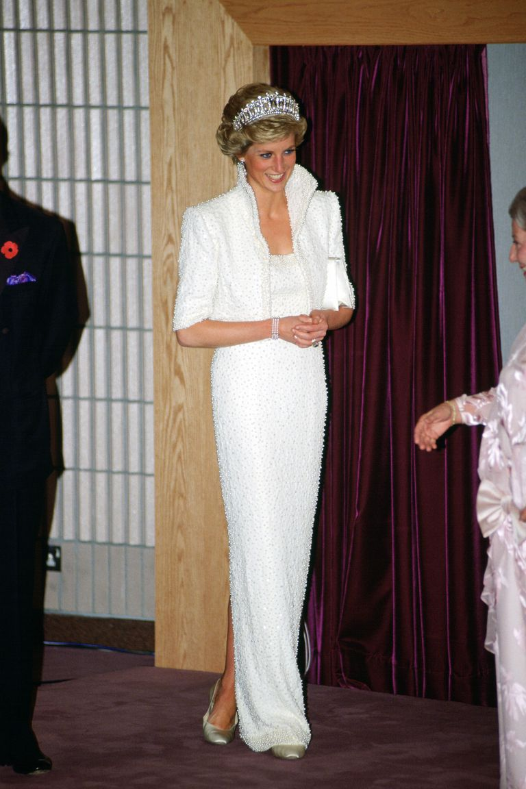 "During a royal visit to Hong Kong, the Princess wore a white silk dress with pearl and sequined detailing by Catherine Walker that is now called ""The Elvis Dress"" by many."