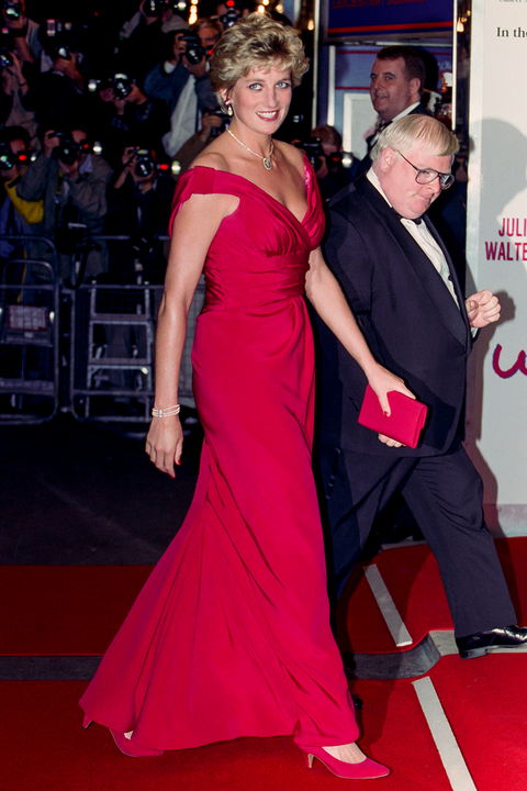 diana princess of wales attends the premiere of just like a woman, in london's west end in 1992 in london wearing a floor length red gown with red accessories
