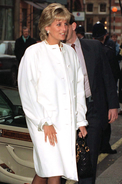 diana arriving at browns hotel in london wearing a white coat designed by fashion designer versace