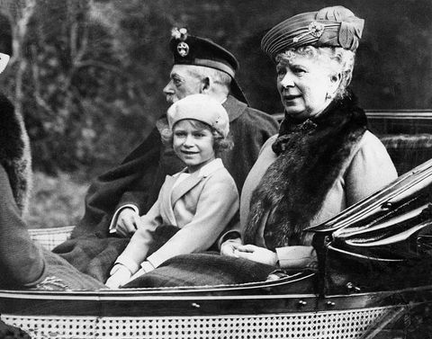 Princess Elizabeth sitting in the horse drawn carriage with her grandparents King George V and Queen Mary on the way bac