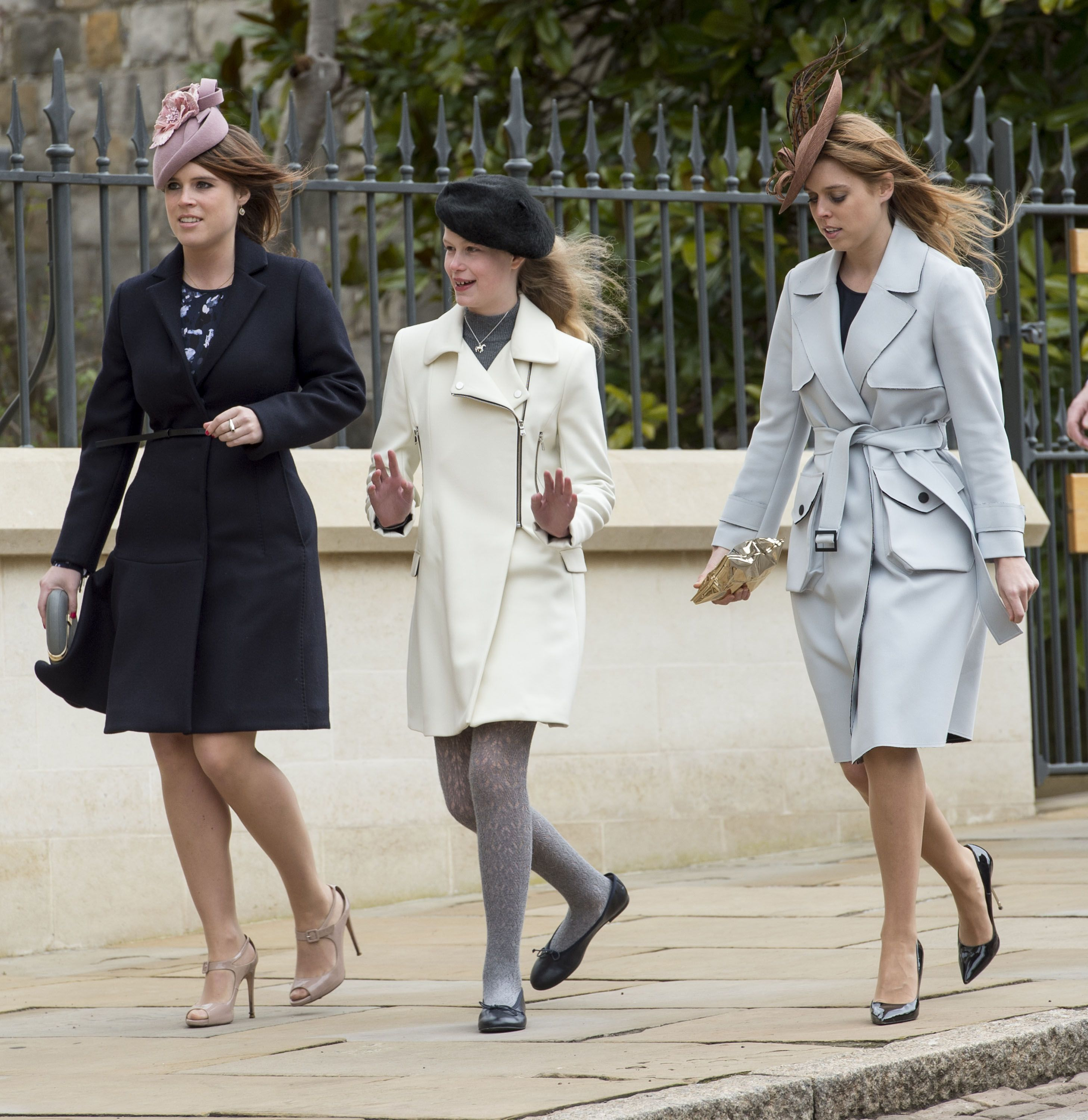 Lady Louise Windsor is flanked by her first cousins Princess Eugenie and Princess Beatrice entering Easter Sunday Service at St. George's Chapel near Windsor Castle in 2016.