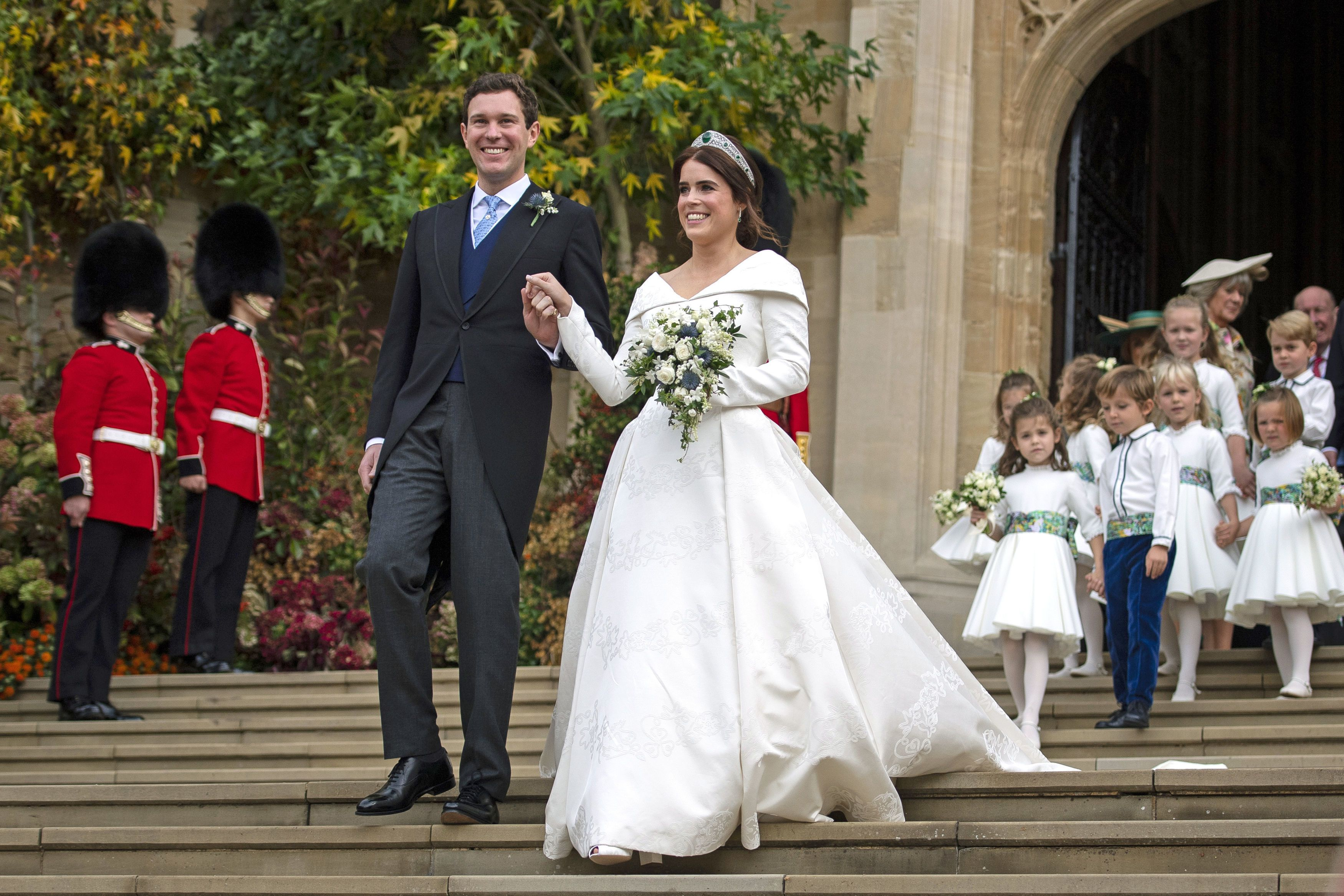 The second of Queen Elizabeth's grandchildren to get married in 2018, Princess Eugenie wed Jack Brooksbank on Friday, October 12, wearing custom Peter Pilotto for their ceremony in Windsor , before changing into blush custom Zac Posen for the evening's festivities.
