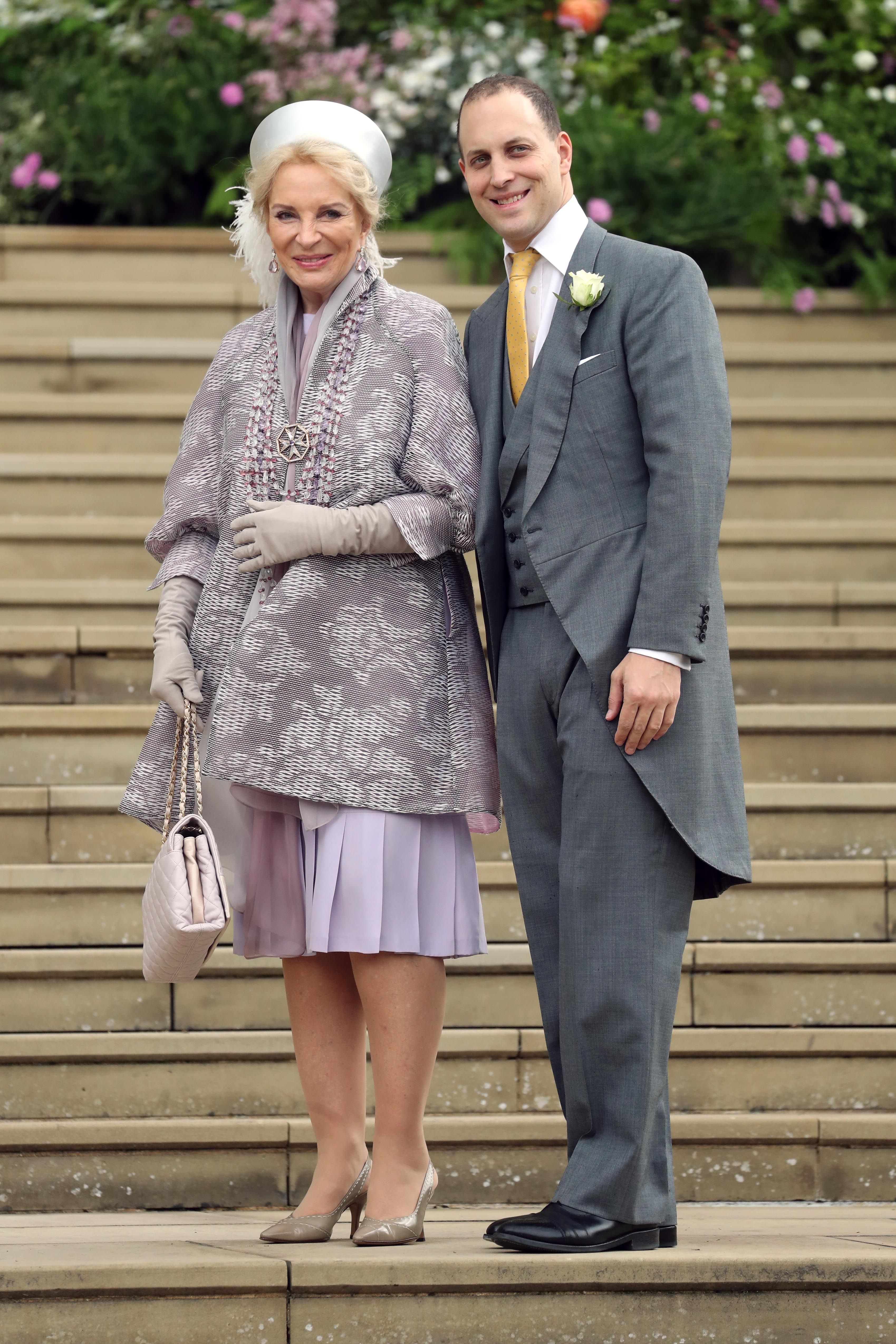 The bride's mother and brother arrive to St George's chapel in Windsor.